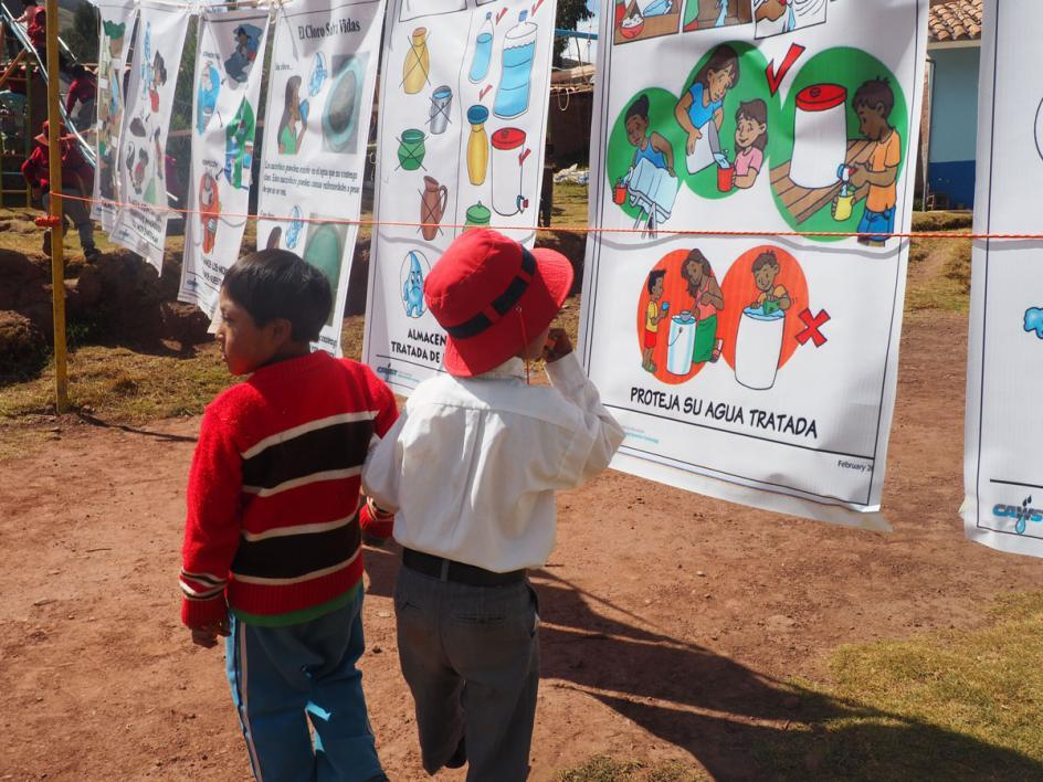 Kids learn about water sanitation and hygiene during Peru's launch day educational seminar.