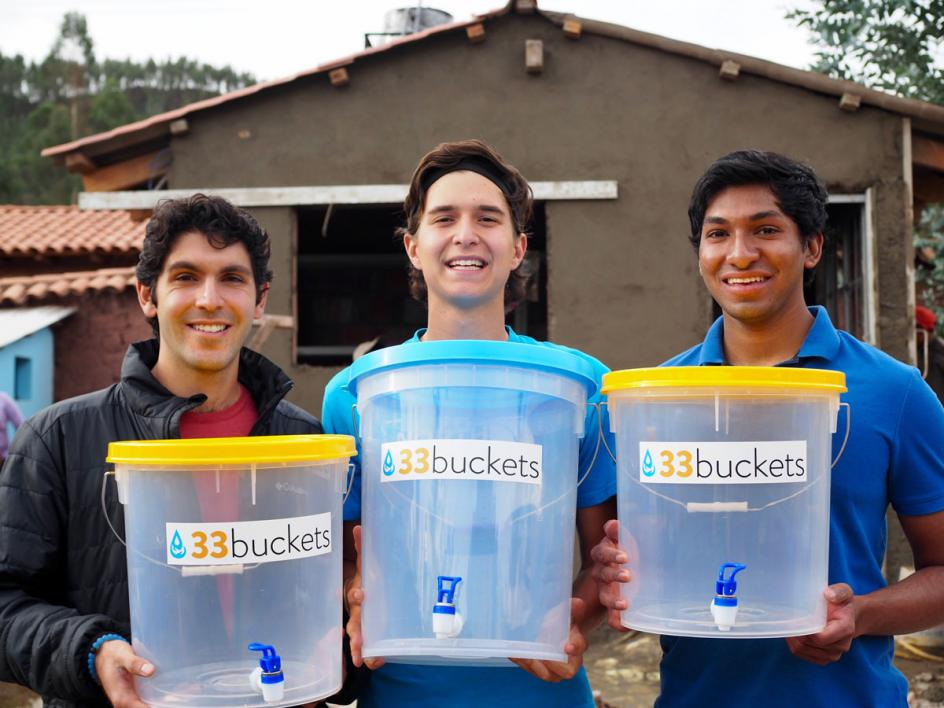 Mark Huerta, Vid Micevic and Swaroon Sridhar of 33 Buckets pose with their water containers in Peru