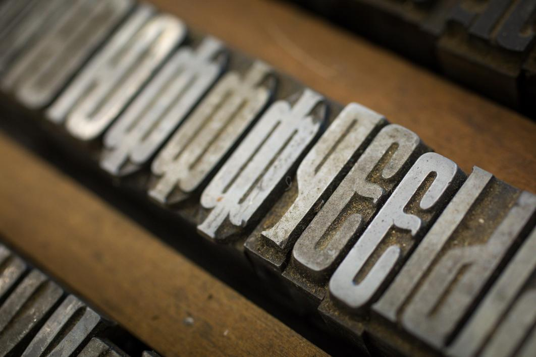 A closeup of metal print type.