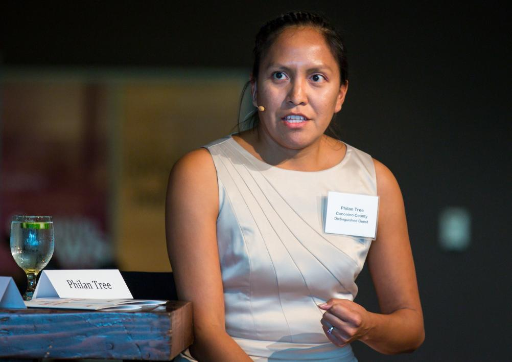A woman speaks during a discussion panel.