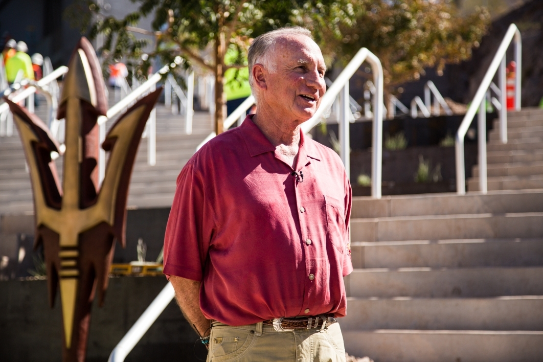 ASU alum Art Pearce standing outside Sun Devil Stadium