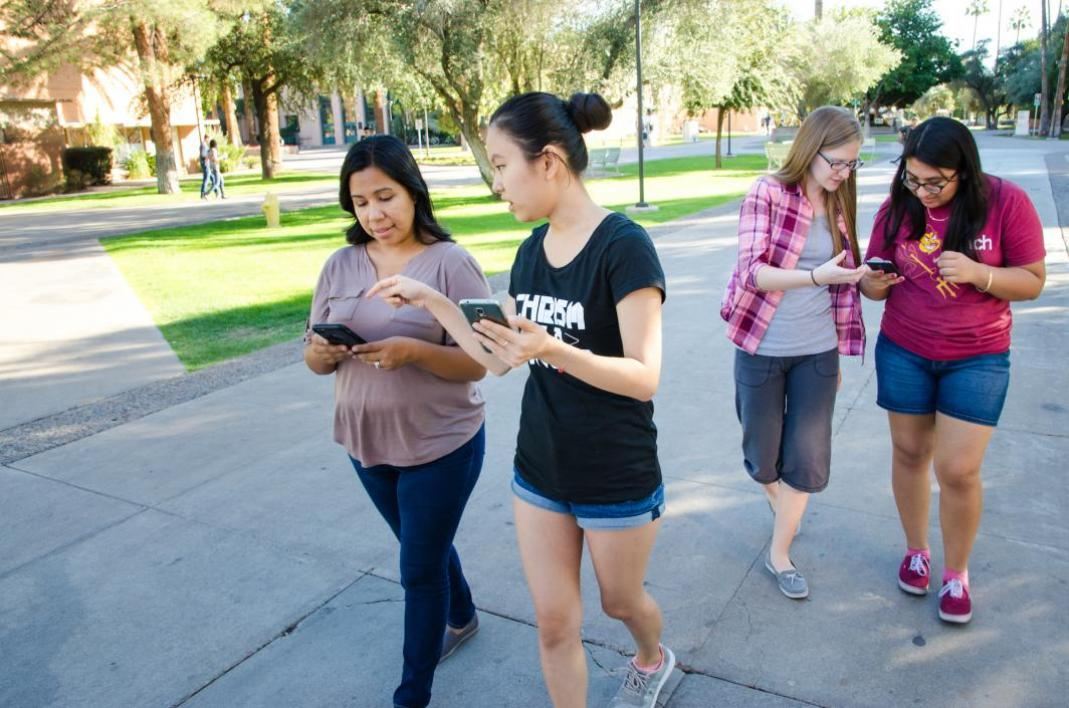 Students play with Pokemon GO