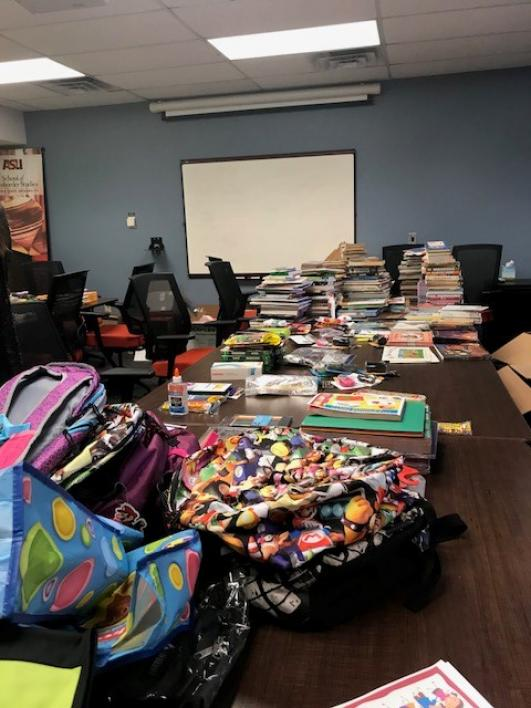 tables full of school supplies in a classroom