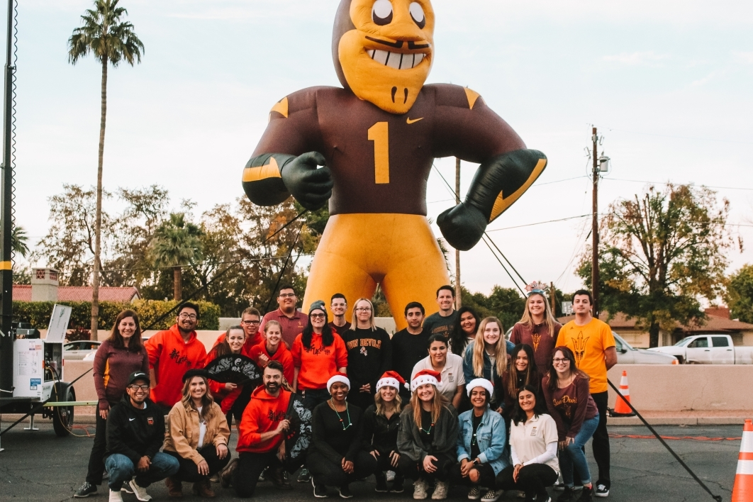 ASU class poses with giant inflatable Sparky