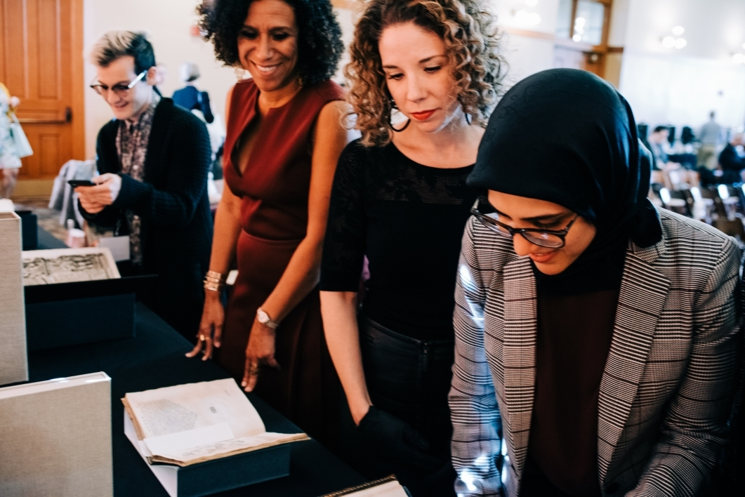 Scholars gather to look at ASU Library's display of medieval manuscripts during RaceB4Race in January 2019