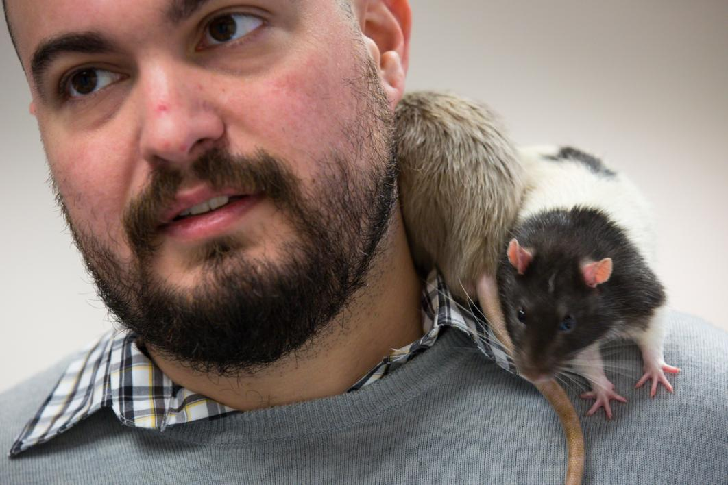 Guy with rats on his shoulder.