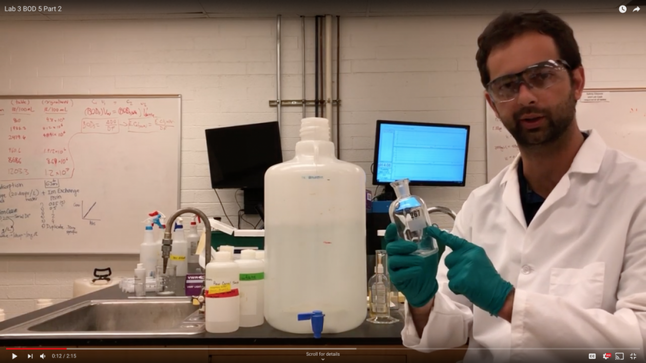 Teaching assistant Thiago Barbosa demonstrates a biochemical oxygen demand lab experiment for Lecturer Mackenzie Boyer's course, CEE 361: Introduction to Environmental Engineering.
