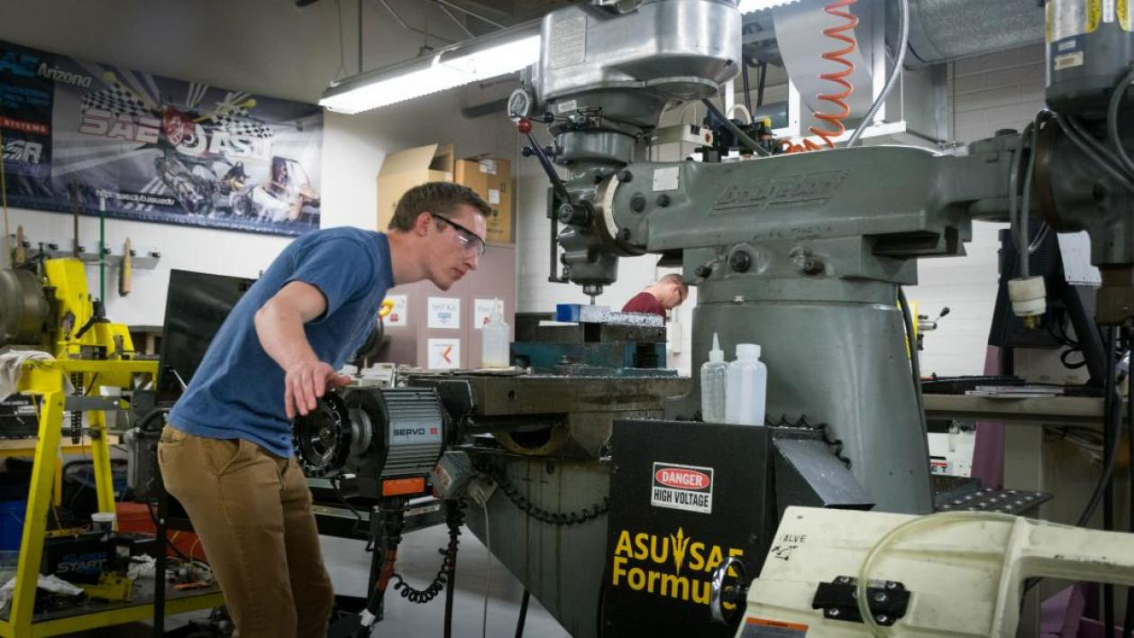 ASU student Sean Berties machines the SAE car brake pedal