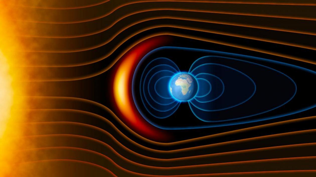 A graphic of the earth showing radiation belts protecting the earth from the sun.