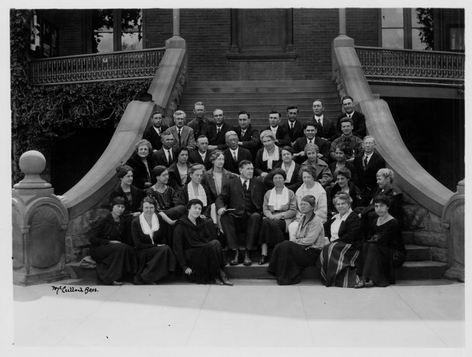 Principal Matthews and staff on the steps of old main