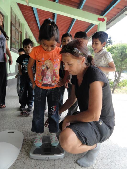 Guatemalan students are weighed as part of an ASU research project.