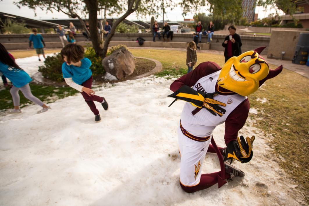 "A mascot ""dies"" during a snow day play day."