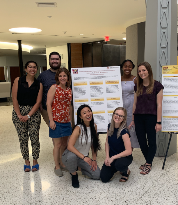 Sofia Chen in front of her research poster with 5 fellow students and one faculty member