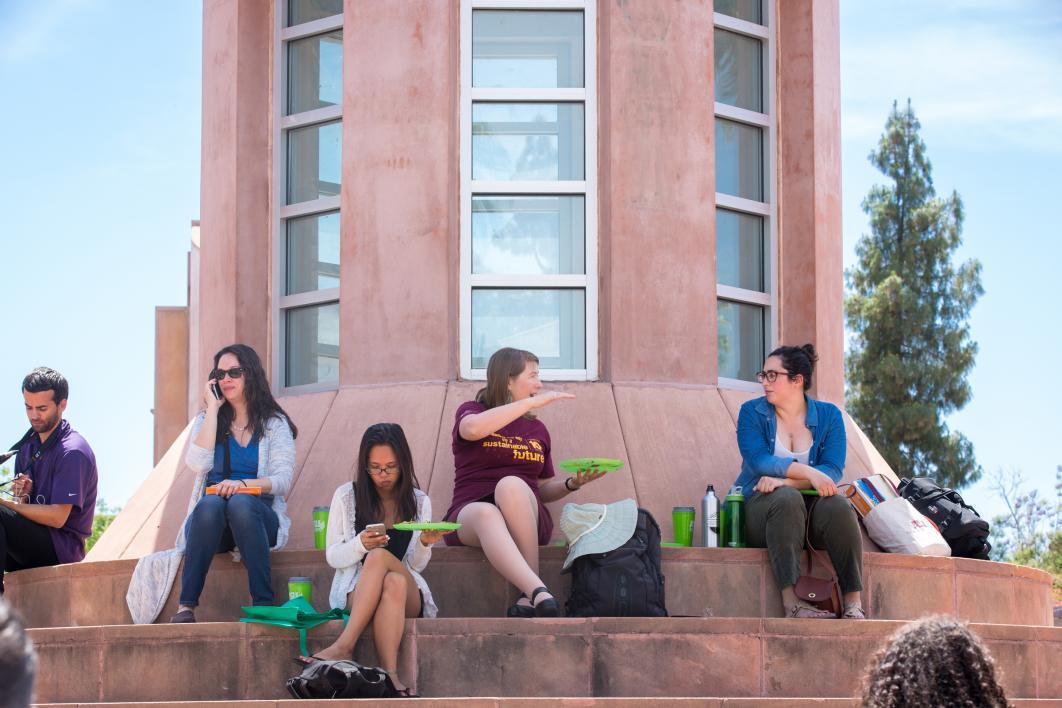 People sitting on Hayden Lawn steps eating food
