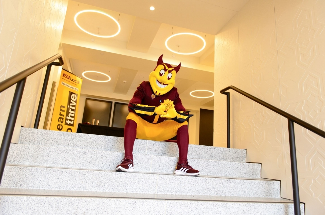 Sparky sitting on a stairway inside the Herald Examiner building.