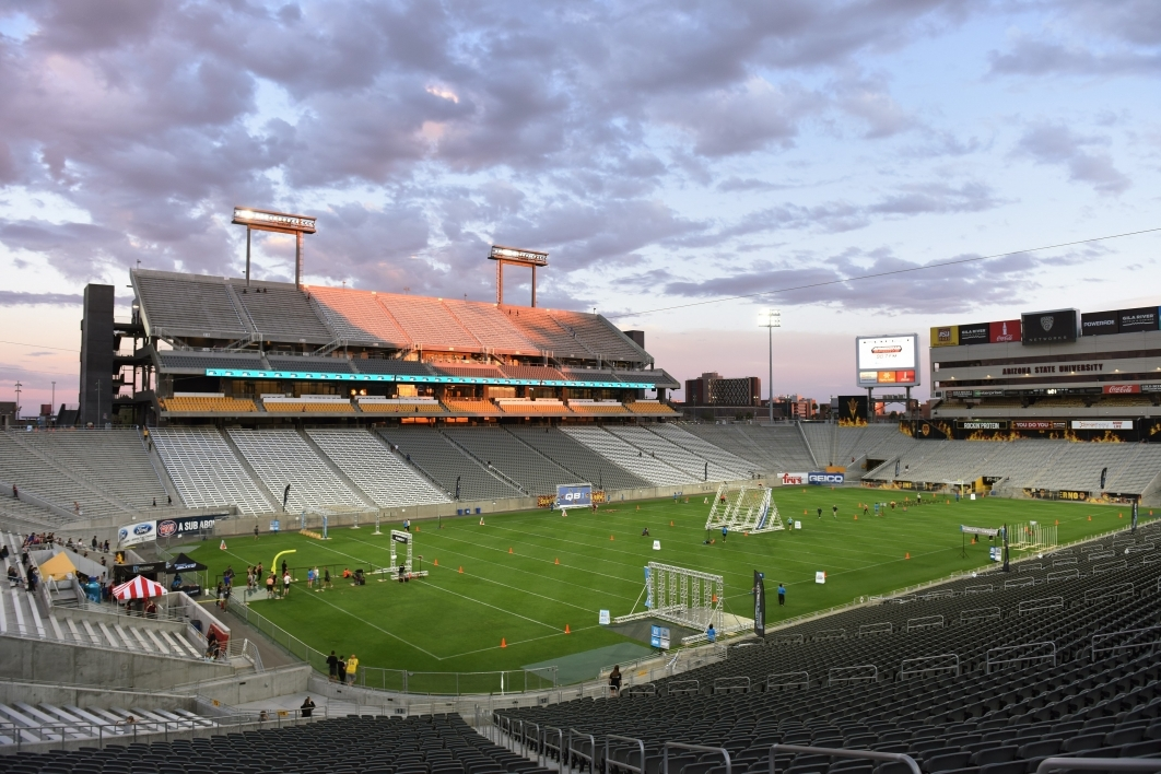 Wide shot of stadium field with obstacles
