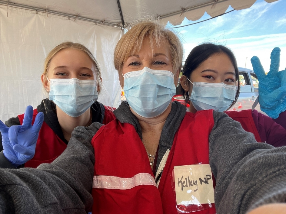 Edson College Students at a drive thru COVID-19 vaccination site