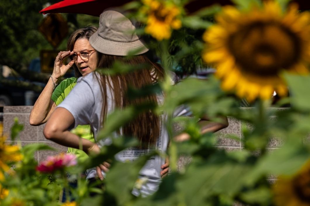 Two people talking in a garden