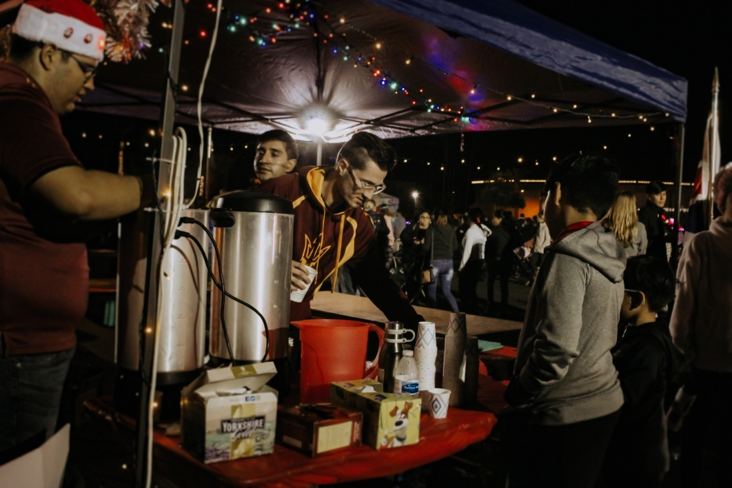 students serving tea and cocoa
