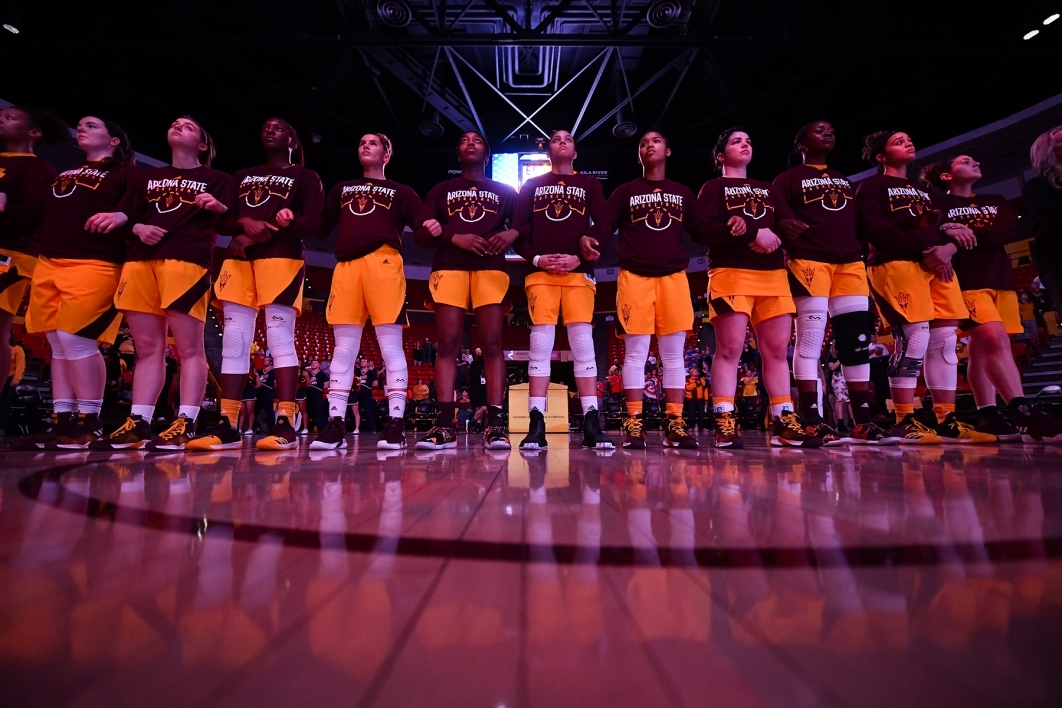 The ASU women hoops team stands in a line on the court