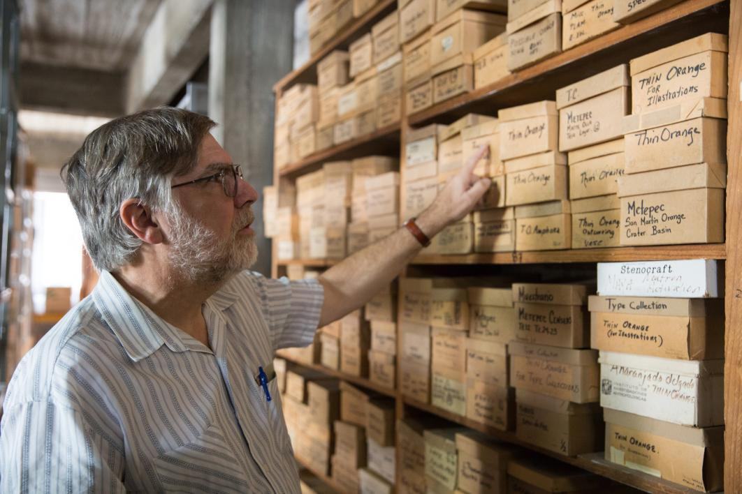 The lab director goes through the stacks at the Teotihuacan Research Laboratory