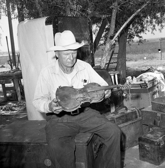 man holding violin