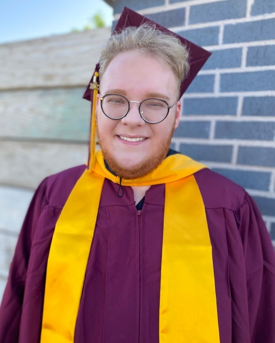 portrait of ASU's College of Health Solutions graduate Adam Thompson wearing his graduation cap and gown