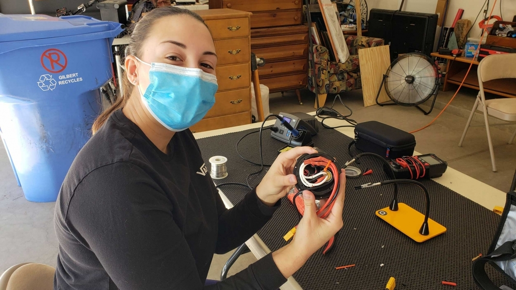 Laura Roty of the mechanical team assembling battery pod 2.