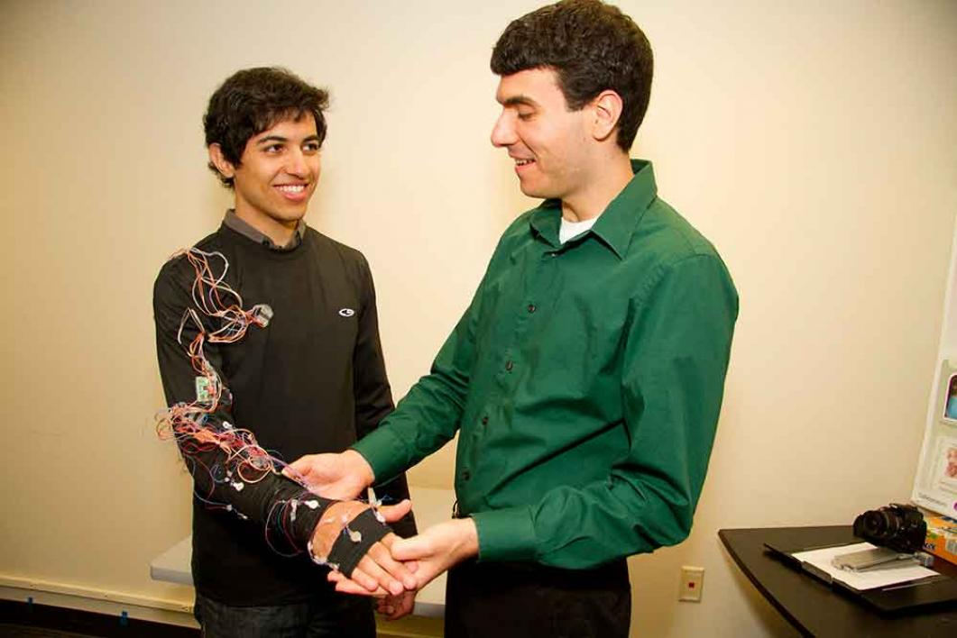 Troy McDaniel (right) develops wearable cyber-physical systems for stroke rehabilitation with undergraduate student Bijan Fakhri.
