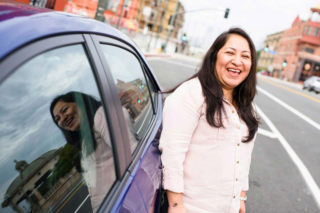 woman standing next to car