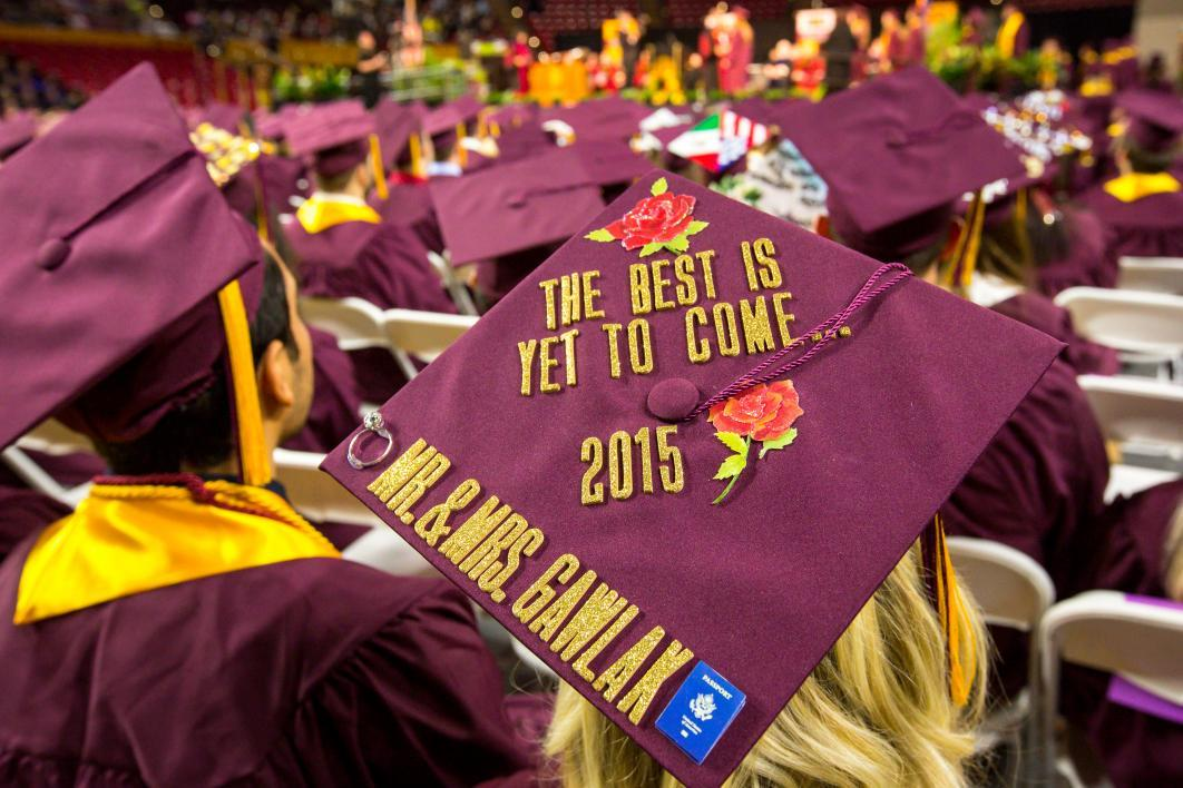 "A graduation cap reads, ""The best is yet to come 2015 . . . Mr and Mrs. Gawlak"