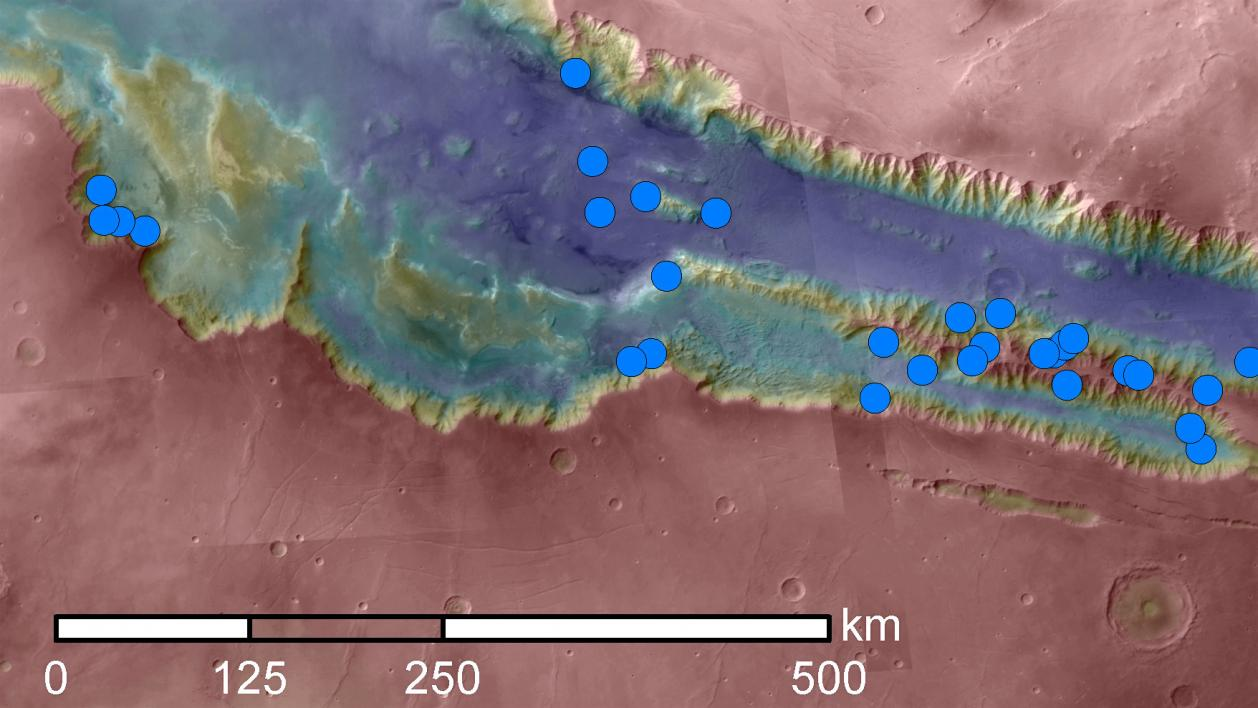 Blue dots mark seasonal dark streak sites in Valles Marineris on Mars