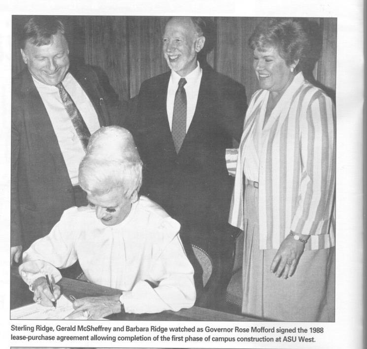 woman signing bill