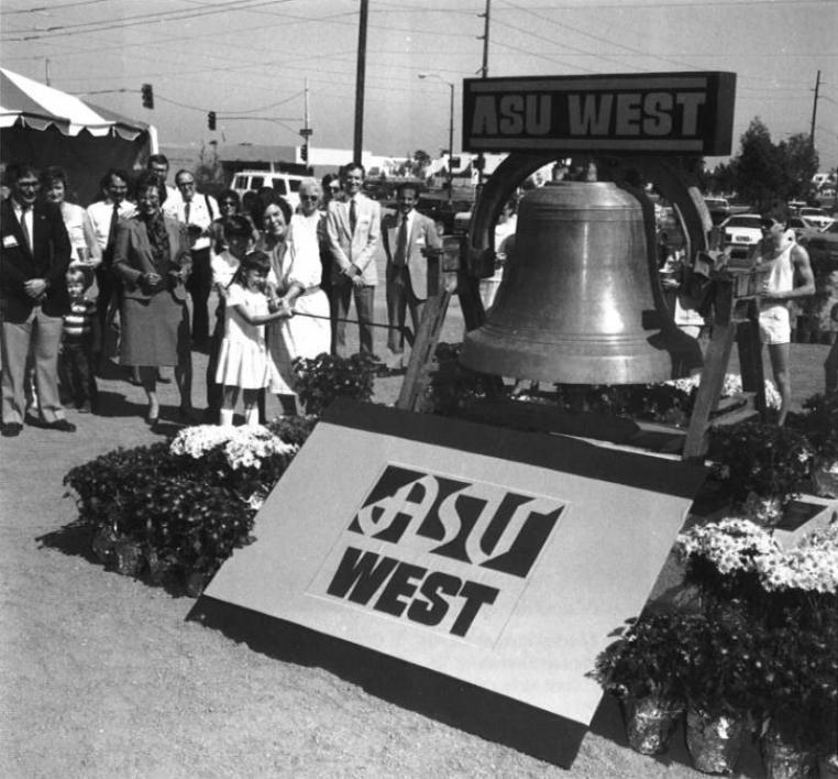 crowd gathered around large bell