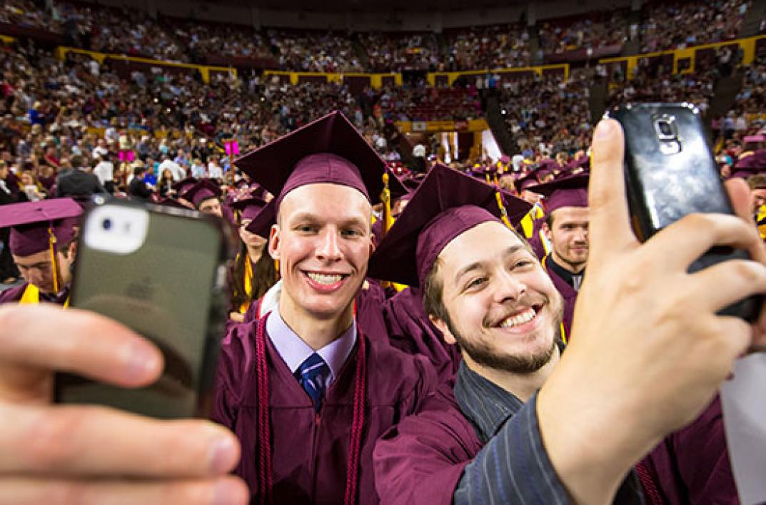 student taking selifes at convocation