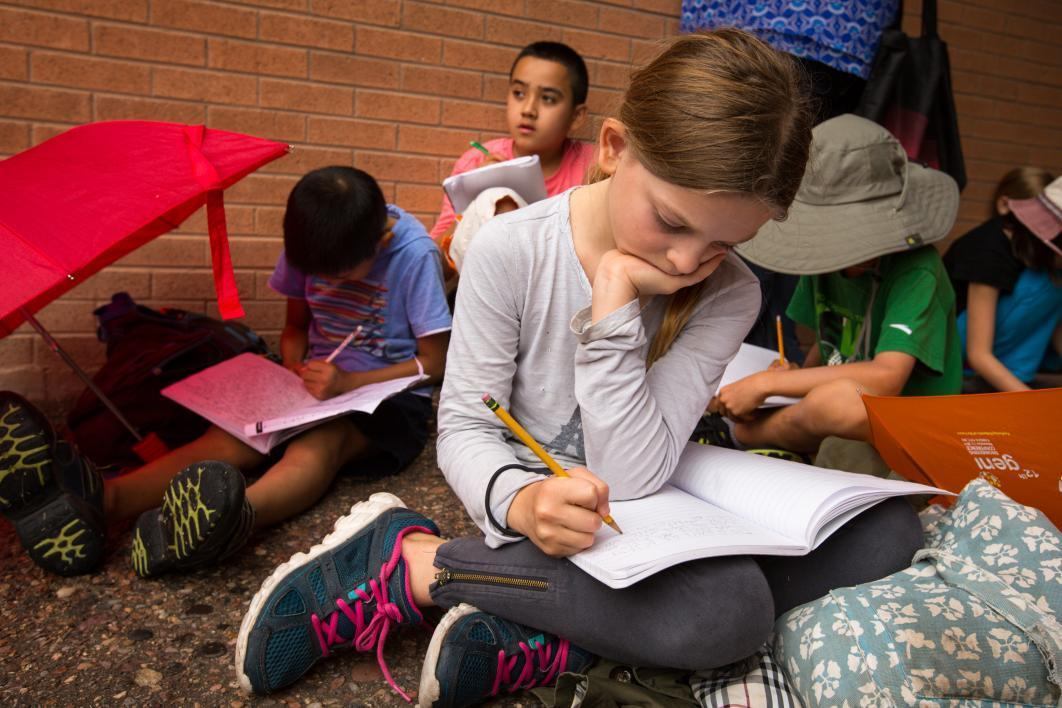 "Students in ASU's youth writing program participate in a ""writing marathon"" in 2015. / Photo by Charlie Leight/ASU Now"