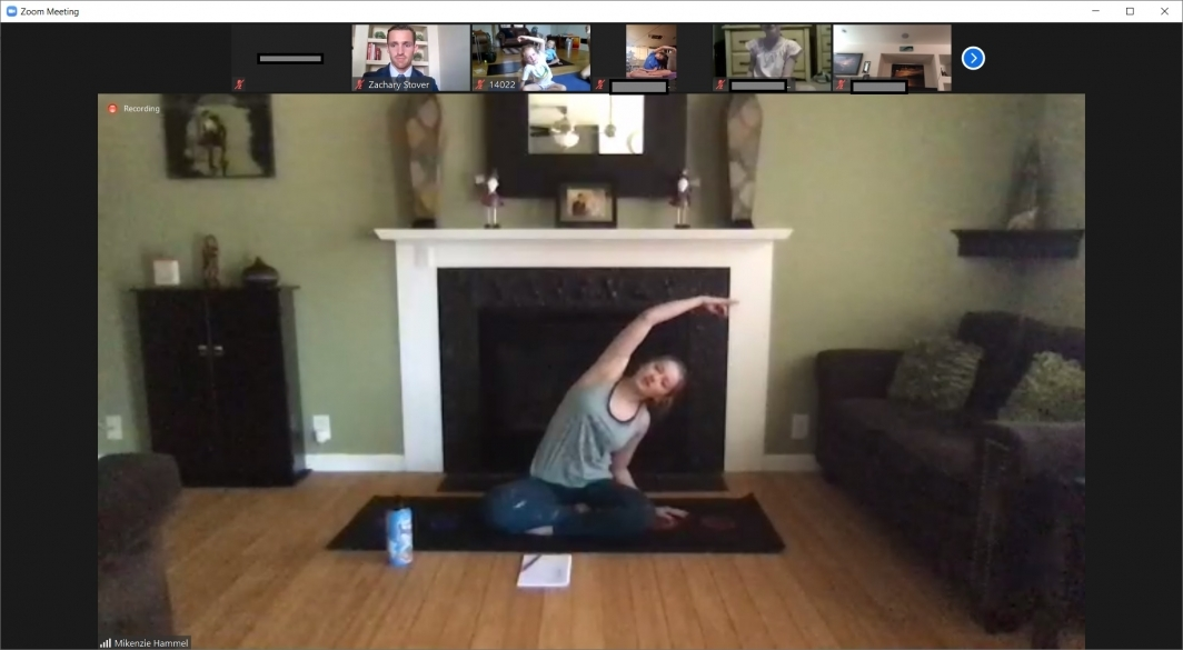 instructor leads yoga session