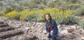 Assistant Professor Chingwen Cheng poses in desert landscape.