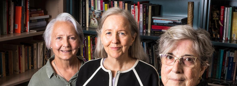 ASU Professors Cynthia Tompkins, Elizabeth Horan and Carmen Urioste-Azcorra smiling in an office with books