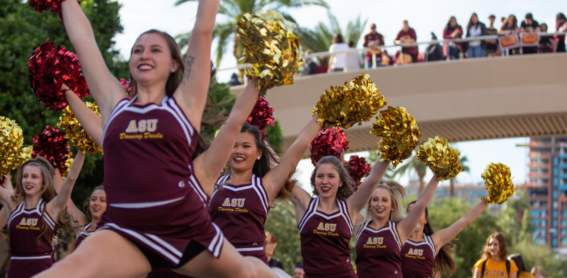 cheerleaders perform at the homecoming parade and block party