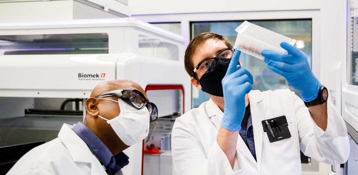 ASU clinical lab staff check a sample block before RNA isolation