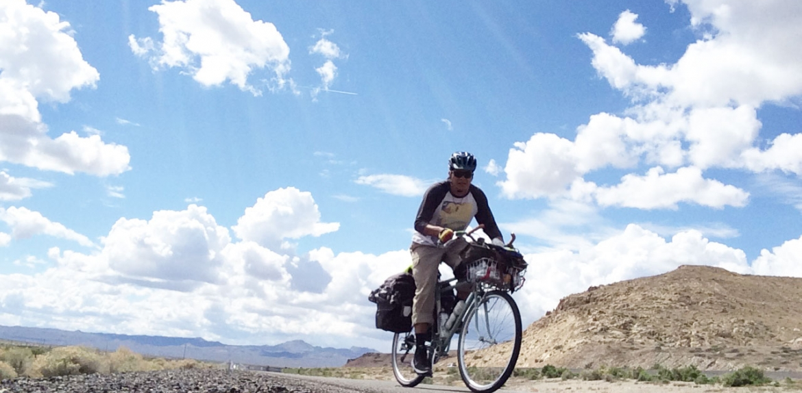 ASU master's student Kenny Dyer-Redner rides a bike through Nevada Indian reservations.