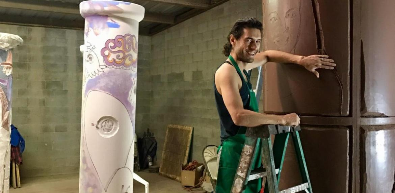 Man working on sculpture