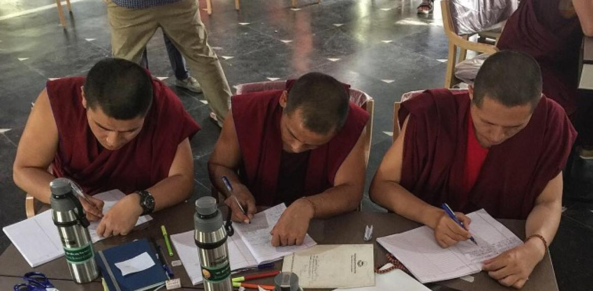 Buddhist monks writing