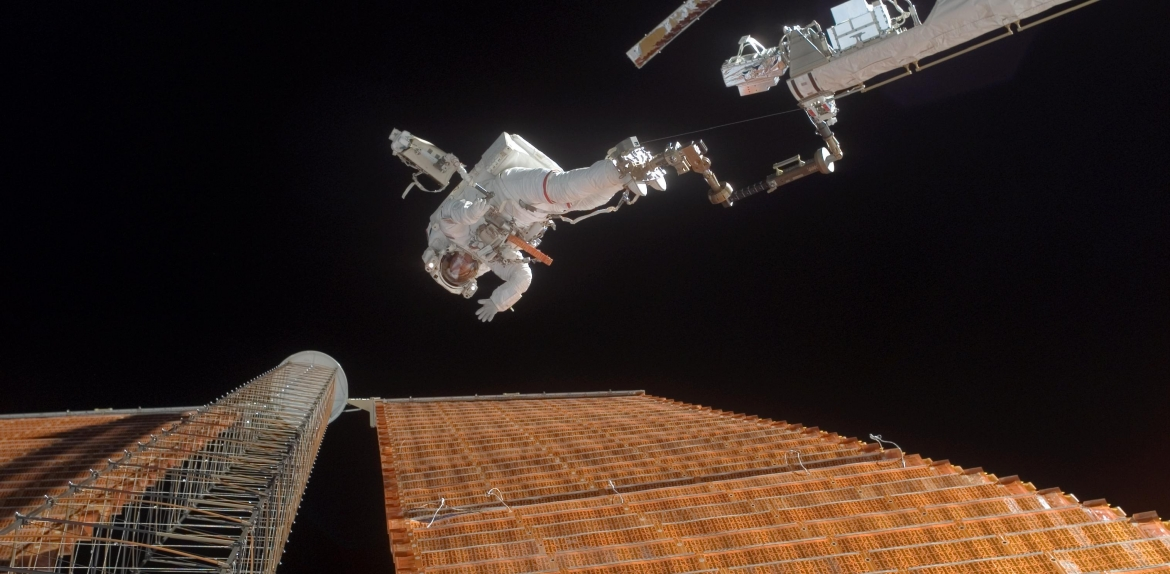 An astronaut floats in space during a space walk maneuver