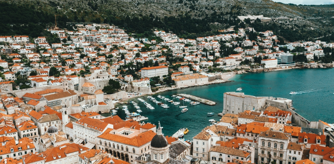 aerial view of Dubrovnik, Croatia showing the roofs of houses next to the sea