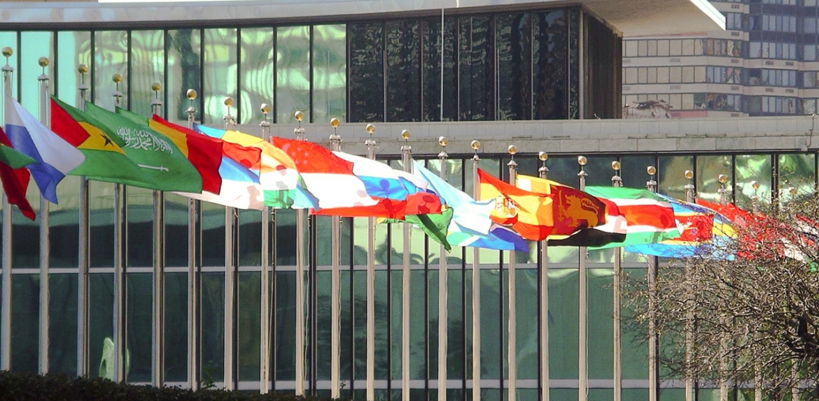 A photograph of international flags at the United Nations