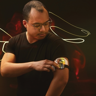 man with wearable tech around his arm
