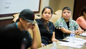 Native entrepreneurs listen during a seminar