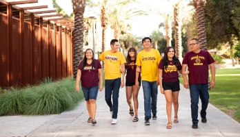 ASU family the Allison's walk down Palm Walk on the Tempe campus